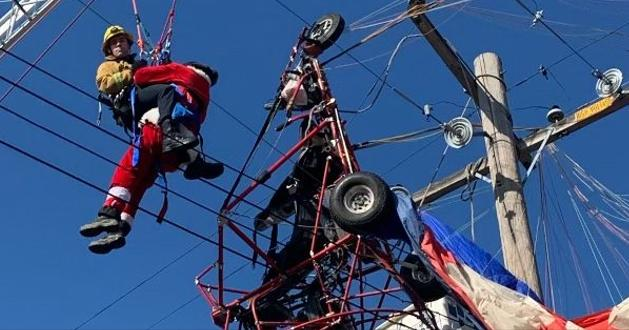 Parachuting Santa Crashes Into Power Lines!